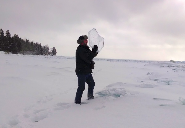 Man holding ice chard from Lake Superior (photo by Kate St. John)